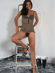 Vivian joins us for a live cam show and hikes up her skirt to show her bushy beaver